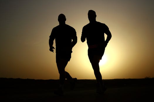 Two men running after hip replacement
